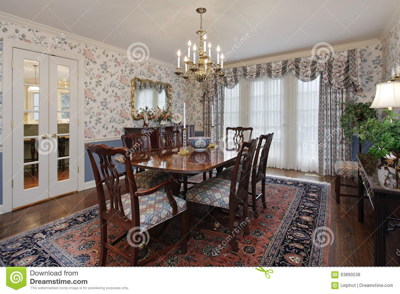 Dining Room In Traditional Home With French Doors