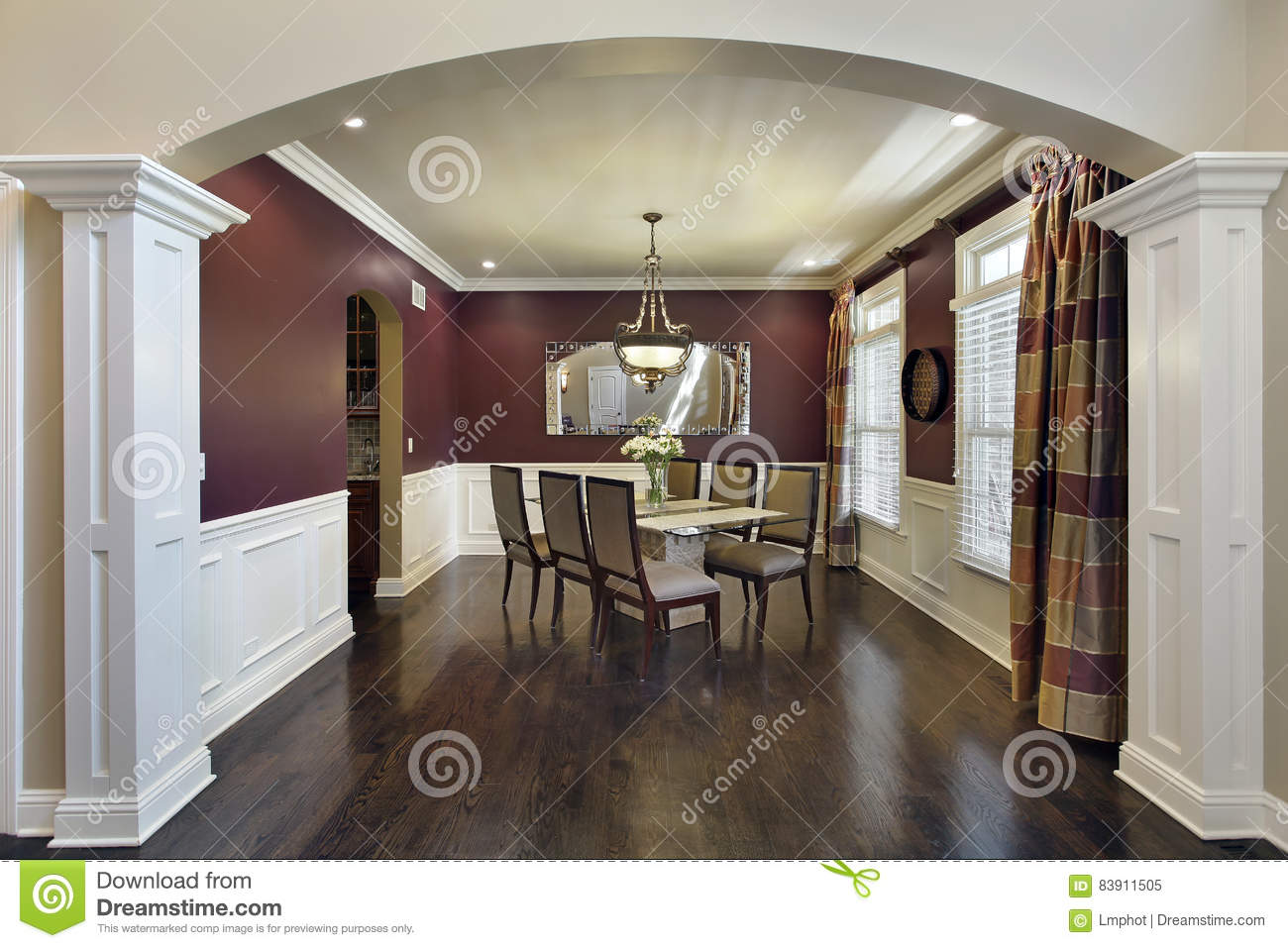 dining room with maroon walls stock photo - image: 83911505