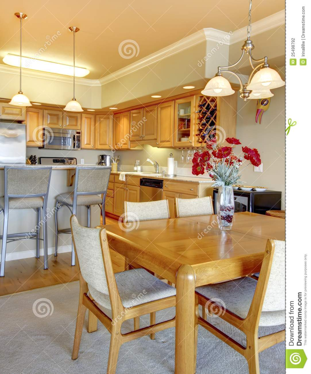 Dining room near luxury kitchen in apartment stock photography image 25498792 - Luxury kitchen room ...