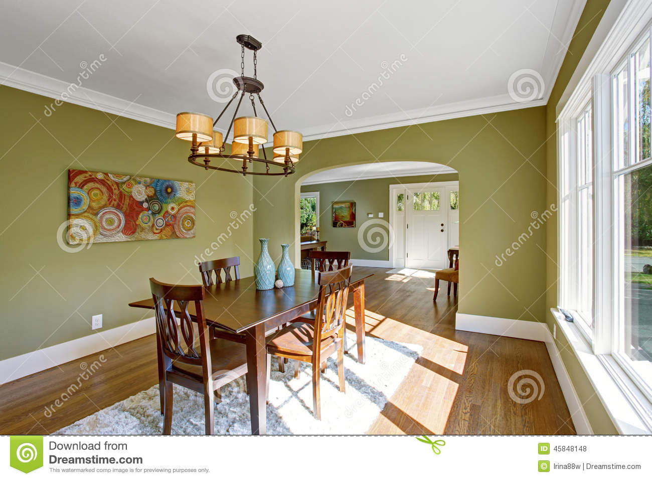 Dining Room With Olive Tone Walls Stock Image