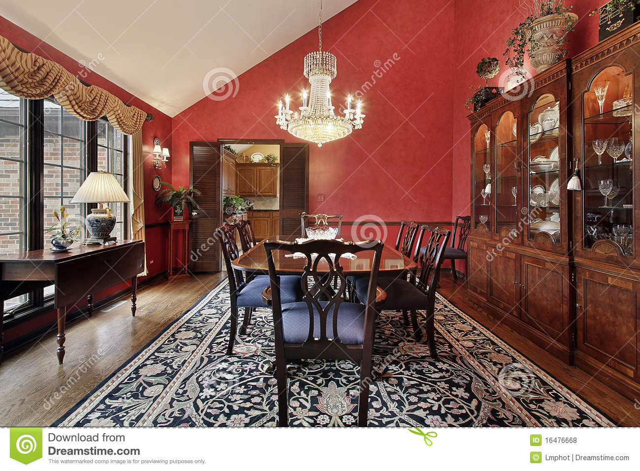 Dining Room With Red Walls Royalty Free Stock Photos
