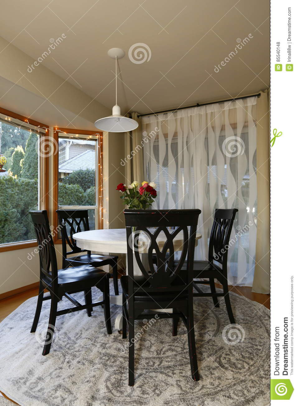Picture of: Dining Room With Round Dining Table And Black Chairs Stock Photo Image Of Home Estate 85540148