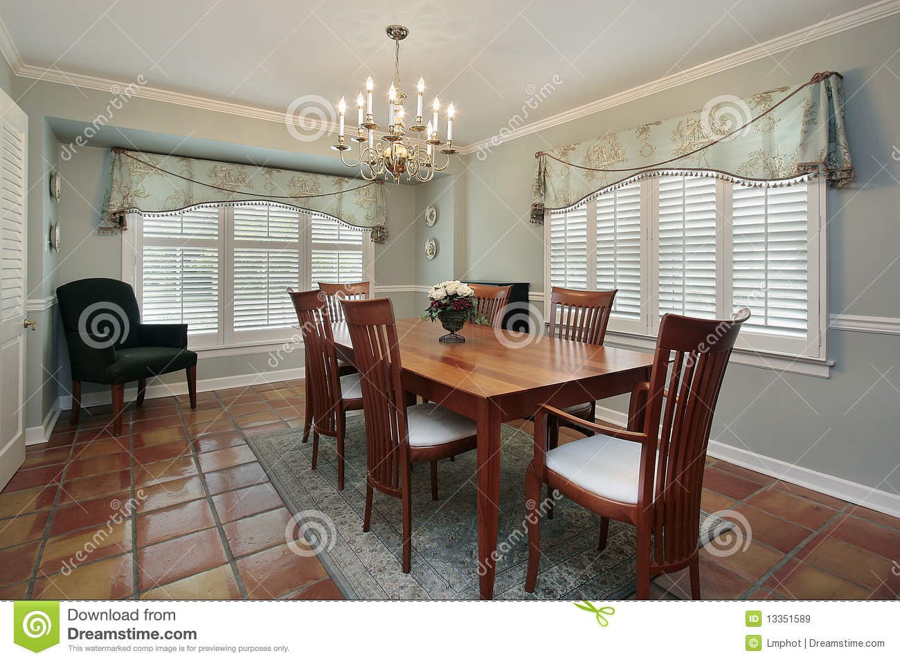 Dining room with spanish floor tiles stock image image of room dining room with spanish floor tiles dailygadgetfo Choice Image