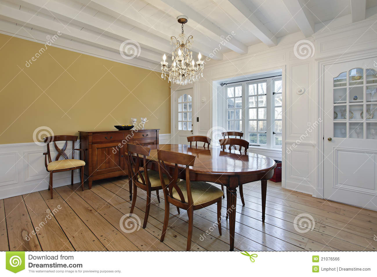 Dining Room With White Ceiling Wood Beams Stock Photo