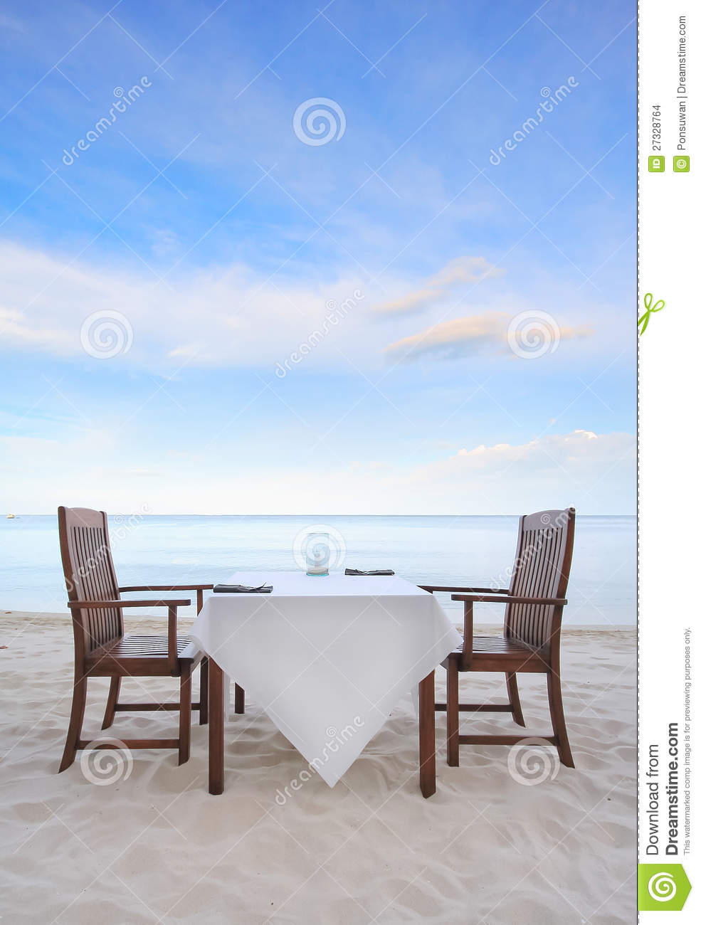Dining table on the beach stock images image 27328764 for Beach dining table