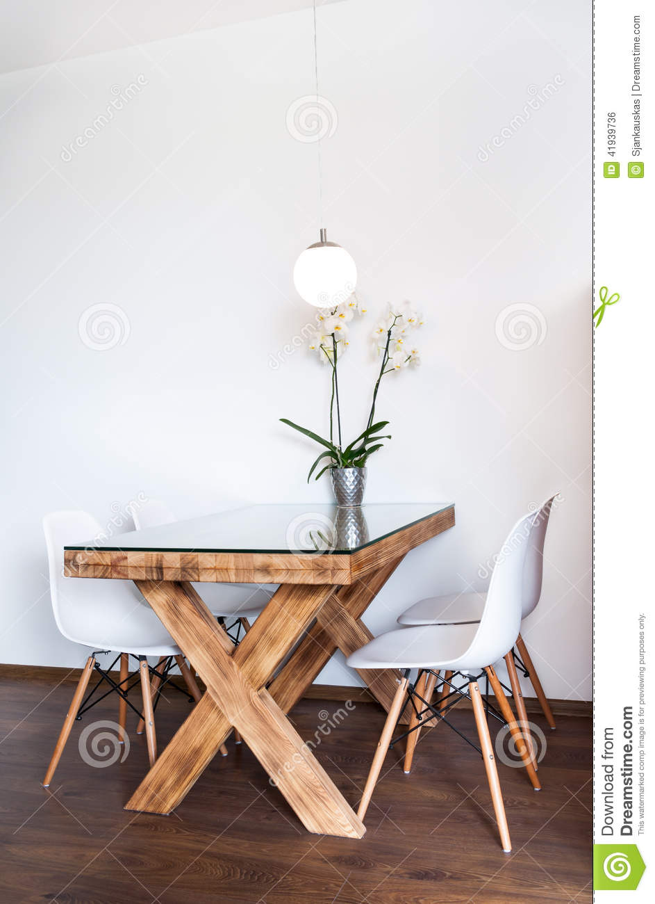Dining Table In A Small Hotel Apartment With Orchid Flowers