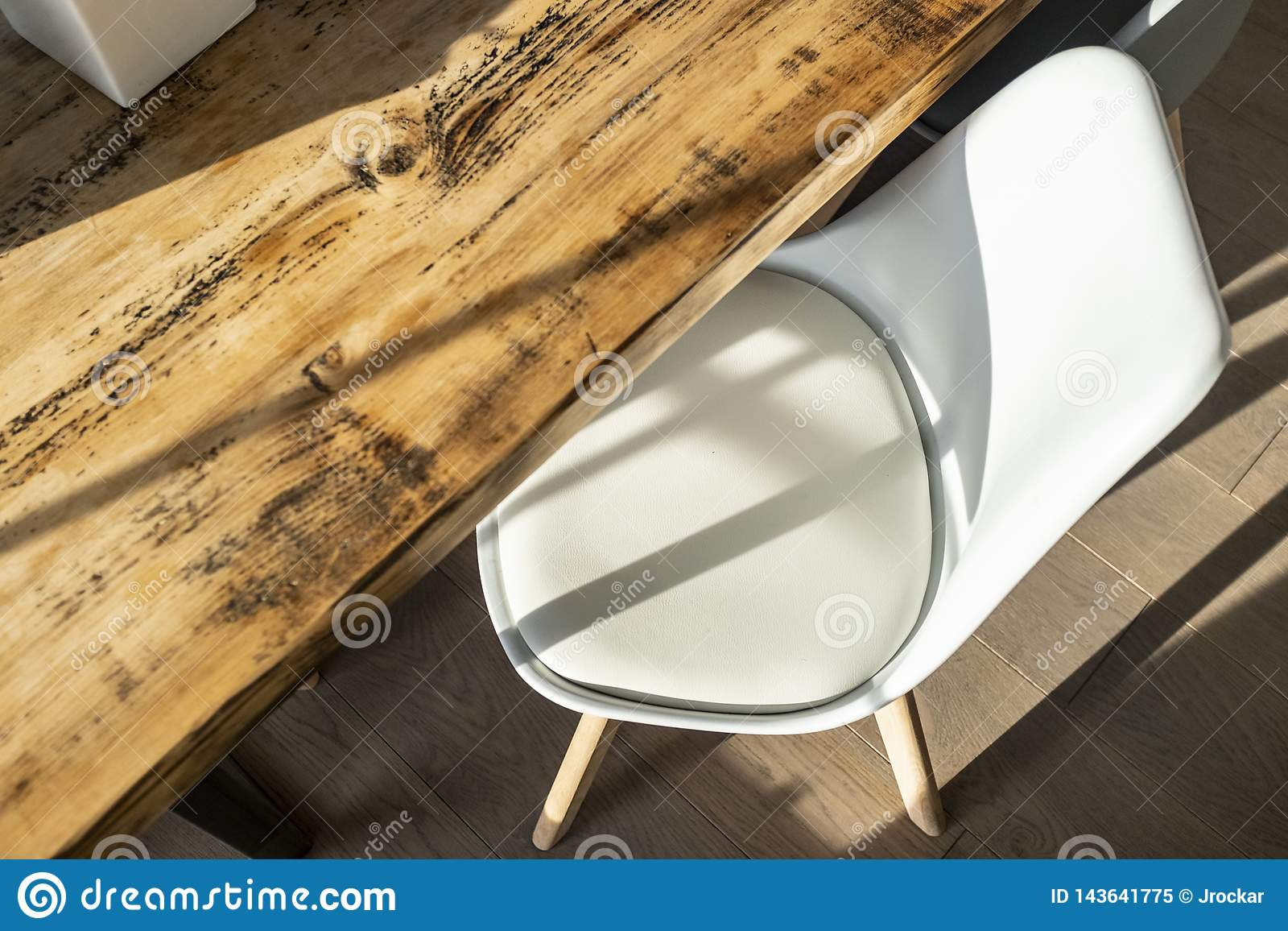 Picture of: Rustic Dining Table With White Faux Leather Chair Stock Image Image Of House White 143641775
