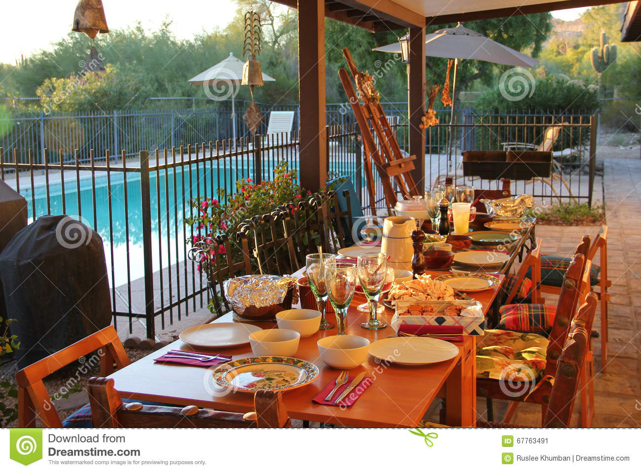 A dining table on a warm sunny day stock photo image for Dinner on the terrace