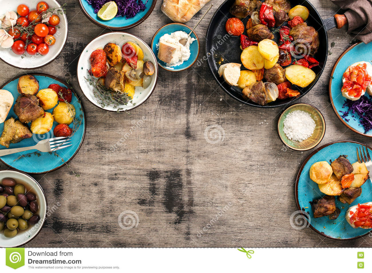 Dinner table with variety food, top view