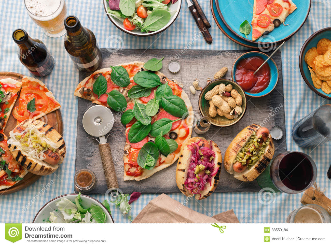dinner table with various food for company top view stock