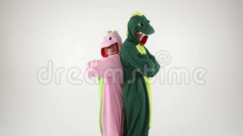 Dinosaur Costumes Absurd Dancing Couple. Funny Party Mood. White Background Video Footage Stock Video - Video of humor happy 109511437 & Dinosaur Costumes Absurd Dancing Couple. Funny Party Mood. White ...