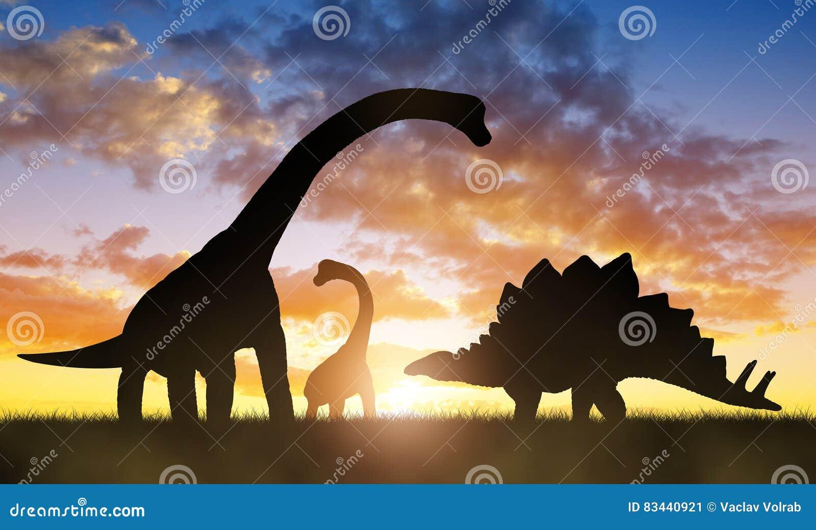 Dinosaures dans le coucher du soleil