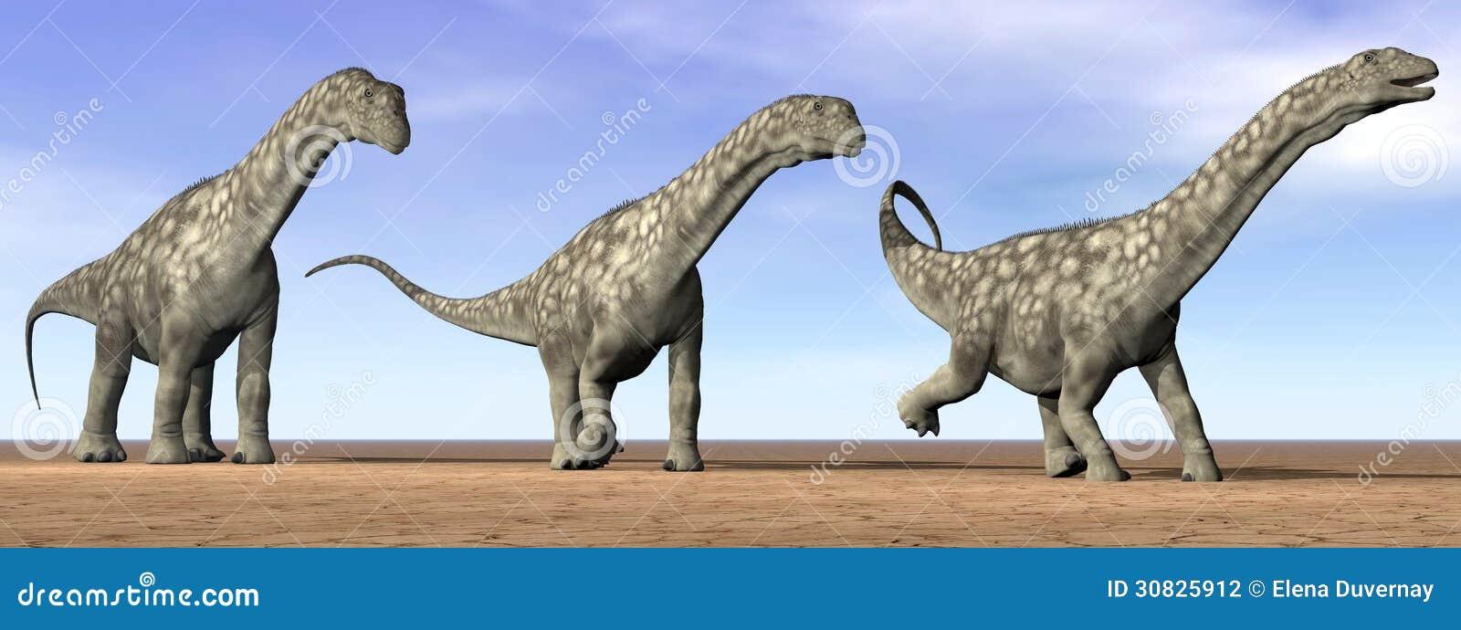 Dinosauri del Argentinosaurus nel deserto - 3D rendono