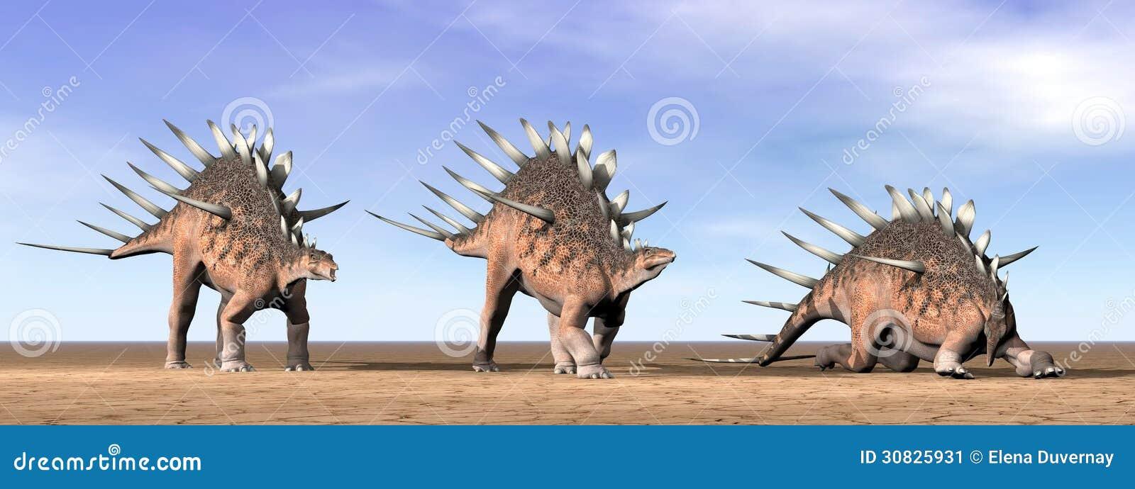 Dinosauri del Kentrosaurus nel deserto - 3D rendono