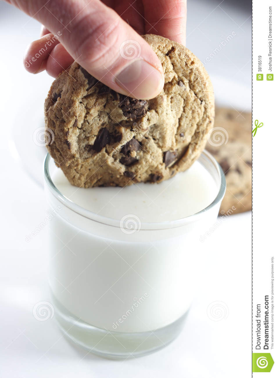 dipping cookie in milk stock image image of consume chocolate chip cookie clipart chocolate chip cookie clip art no background
