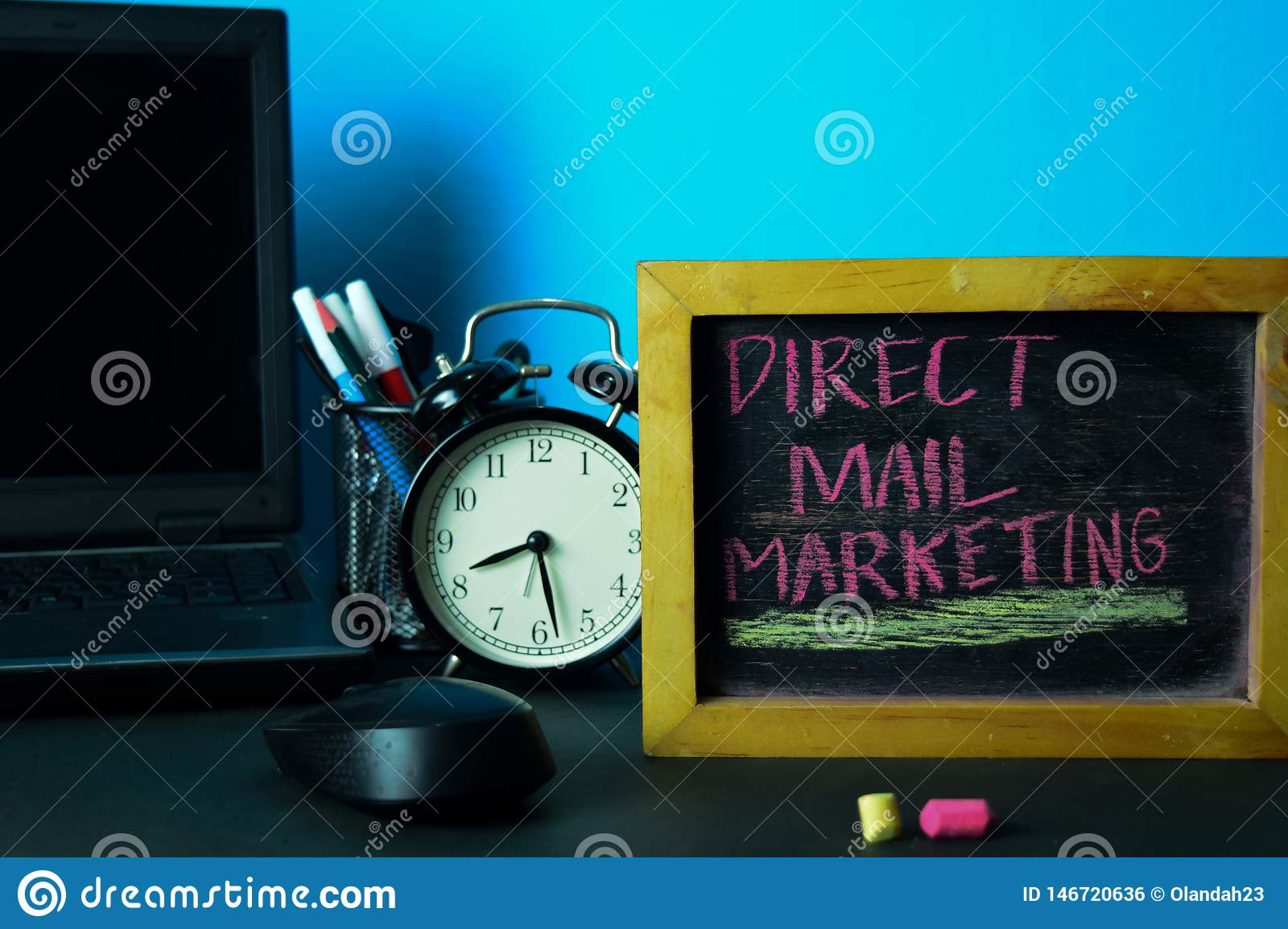 Direct Mail Marketing Planning on Background of Working Table with Office Supplies.