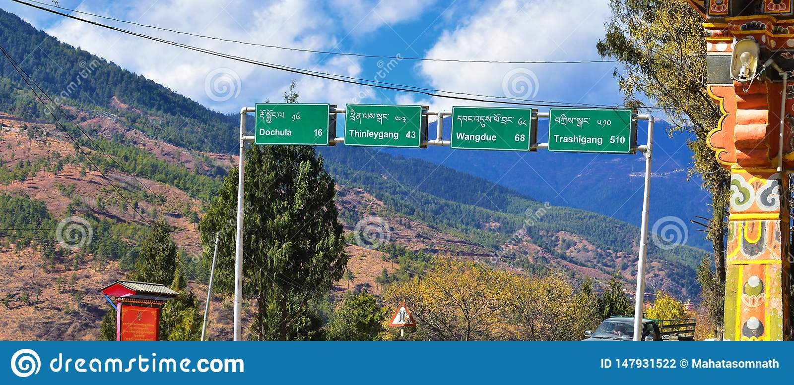 Direction road signs at highway to Dochala in Bhutan