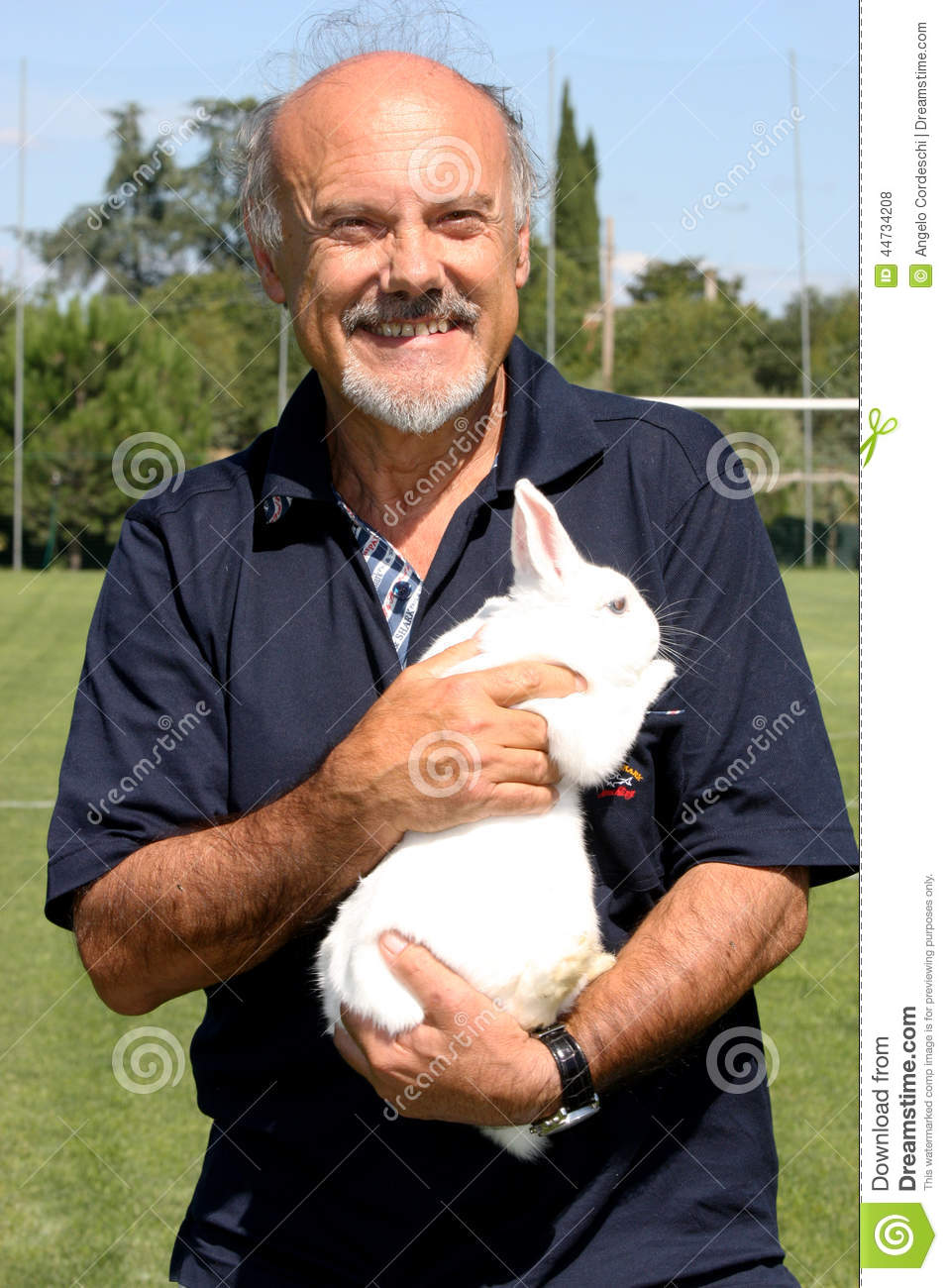 The director Luciano Capponi with a rabbit in her arms