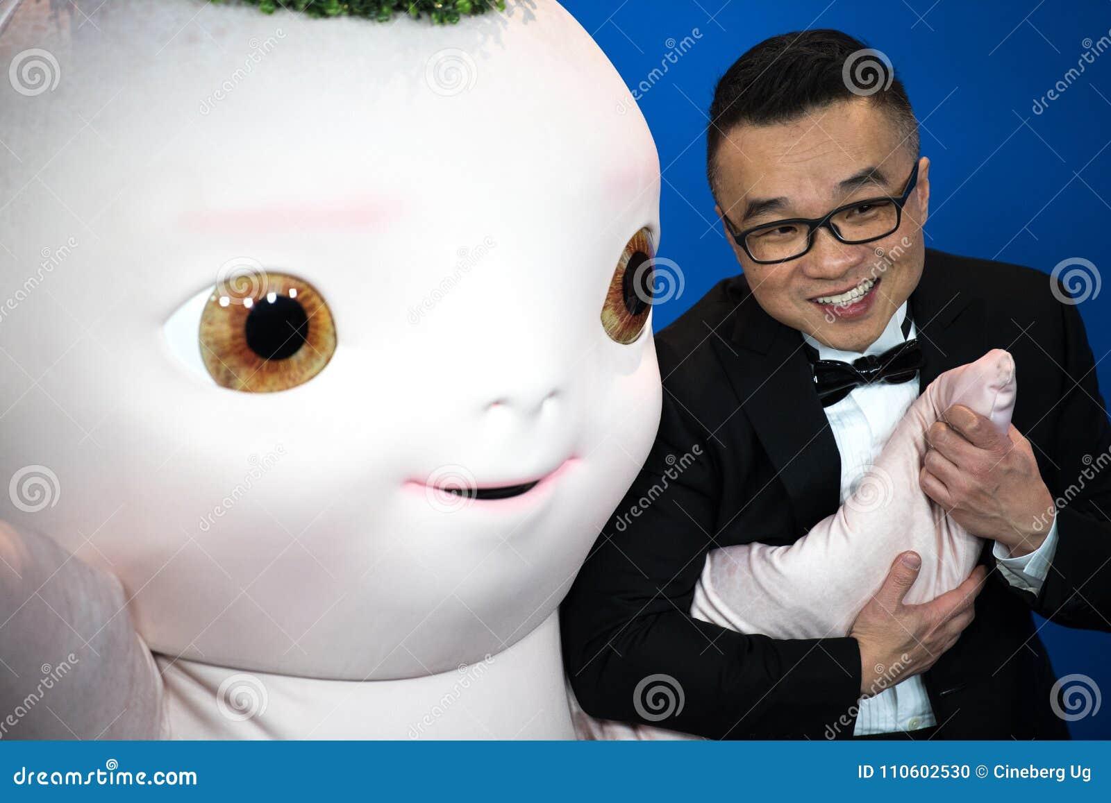 Director Raman Hui And `Buba Monster` Pose During Berlinale