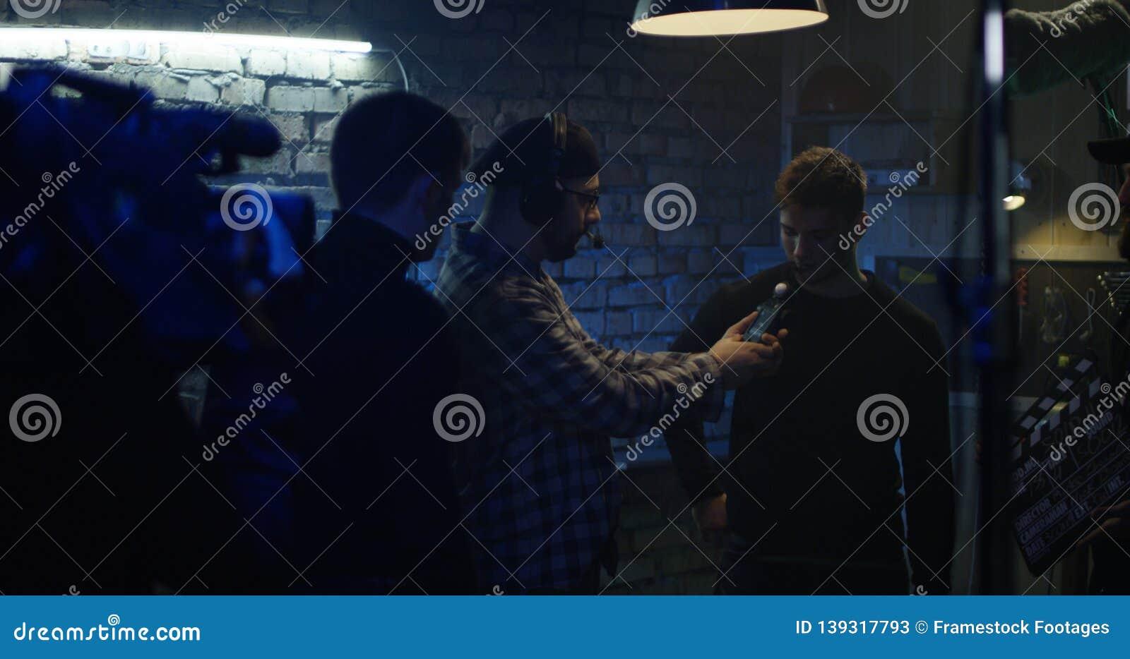 Director coordinating actors in fight scene