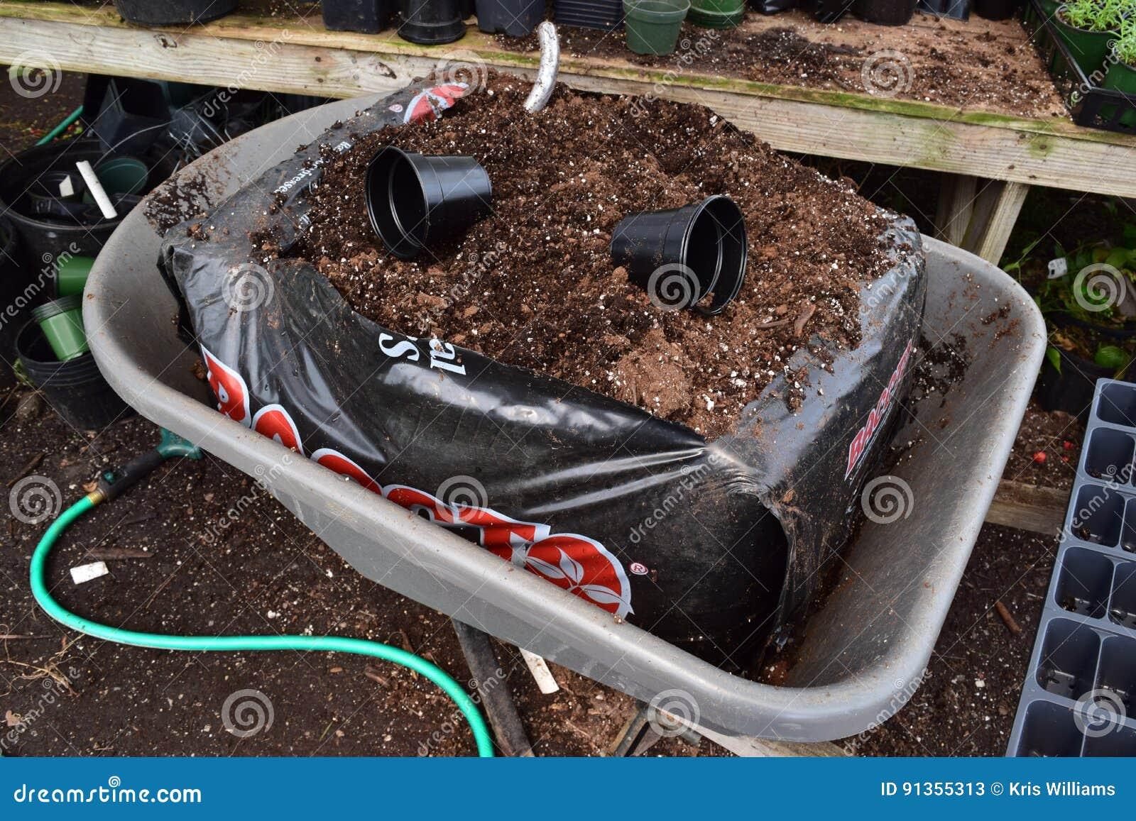 Dirt bag in a wheelbarrow