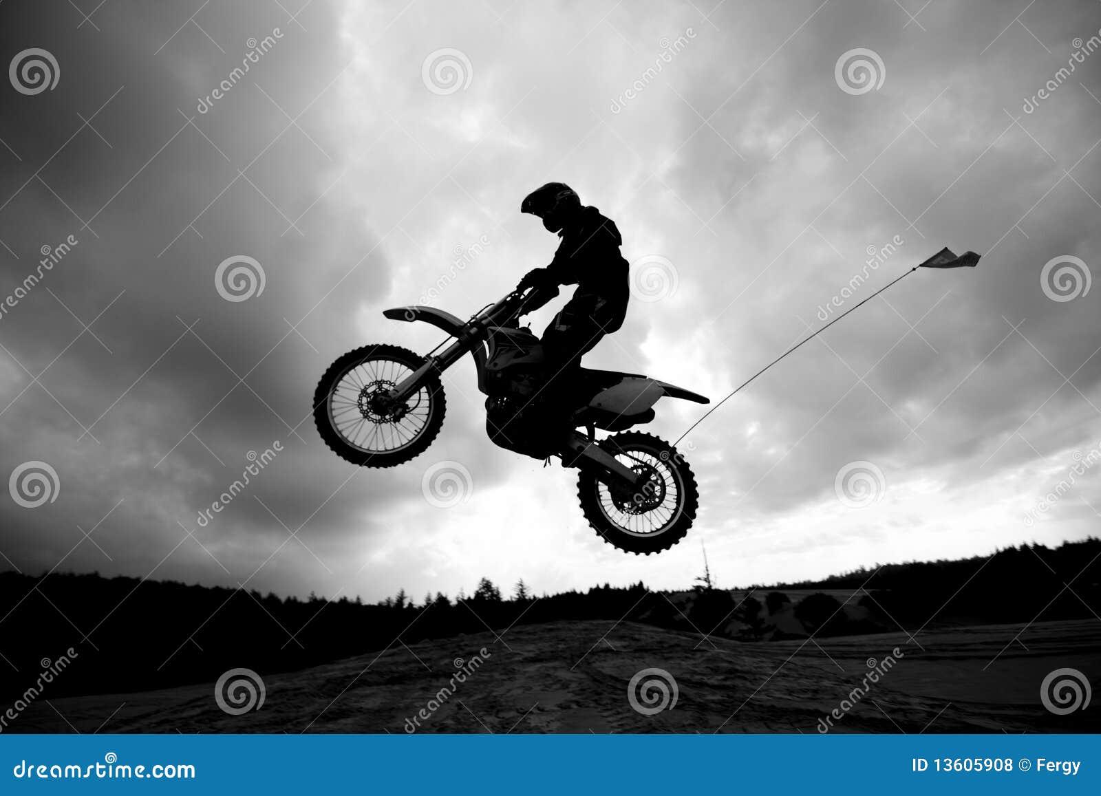 Dirt Bike Jumping Sand Dunes Sihlouette Royalty Free Stock