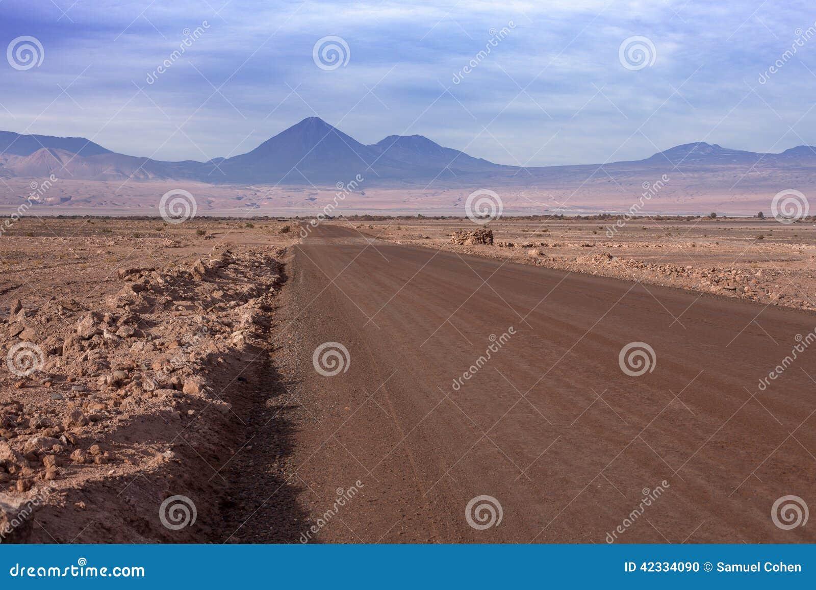 A dirt road leads to the Volcano Licancabur in San Pedro de Atacama
