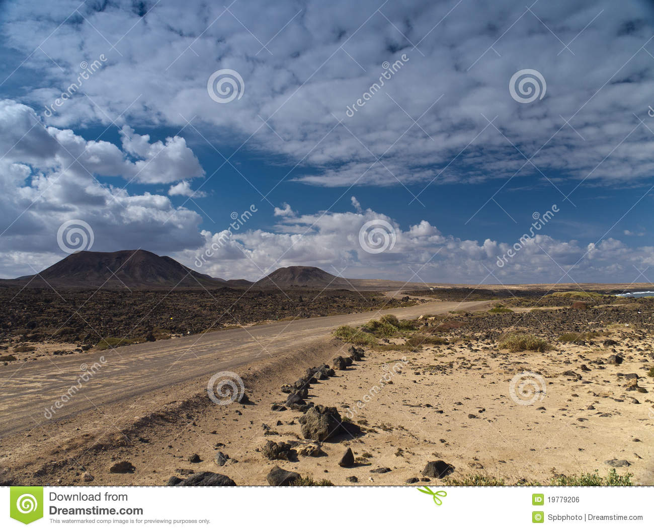 Download Dirt Road Through The Snony Desert Stock Photo - Image of desert, cloud: 19779206