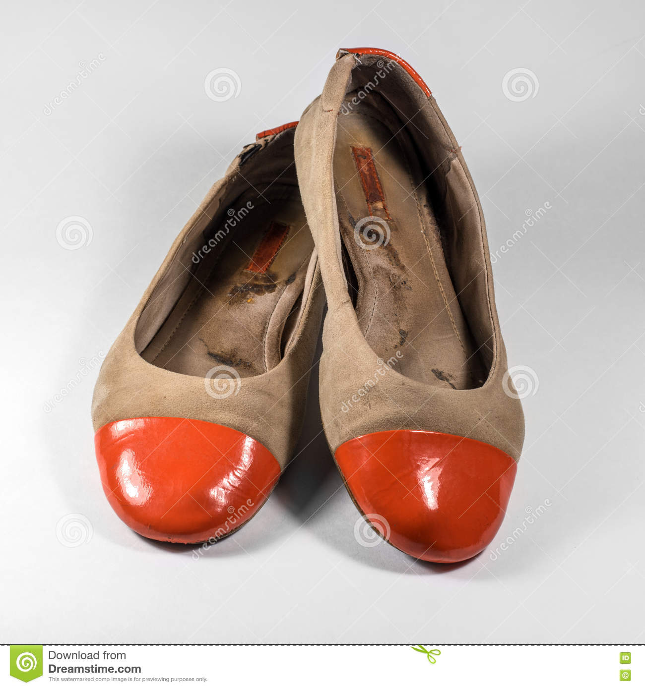 Dirty female shoes with orange socks glossy.