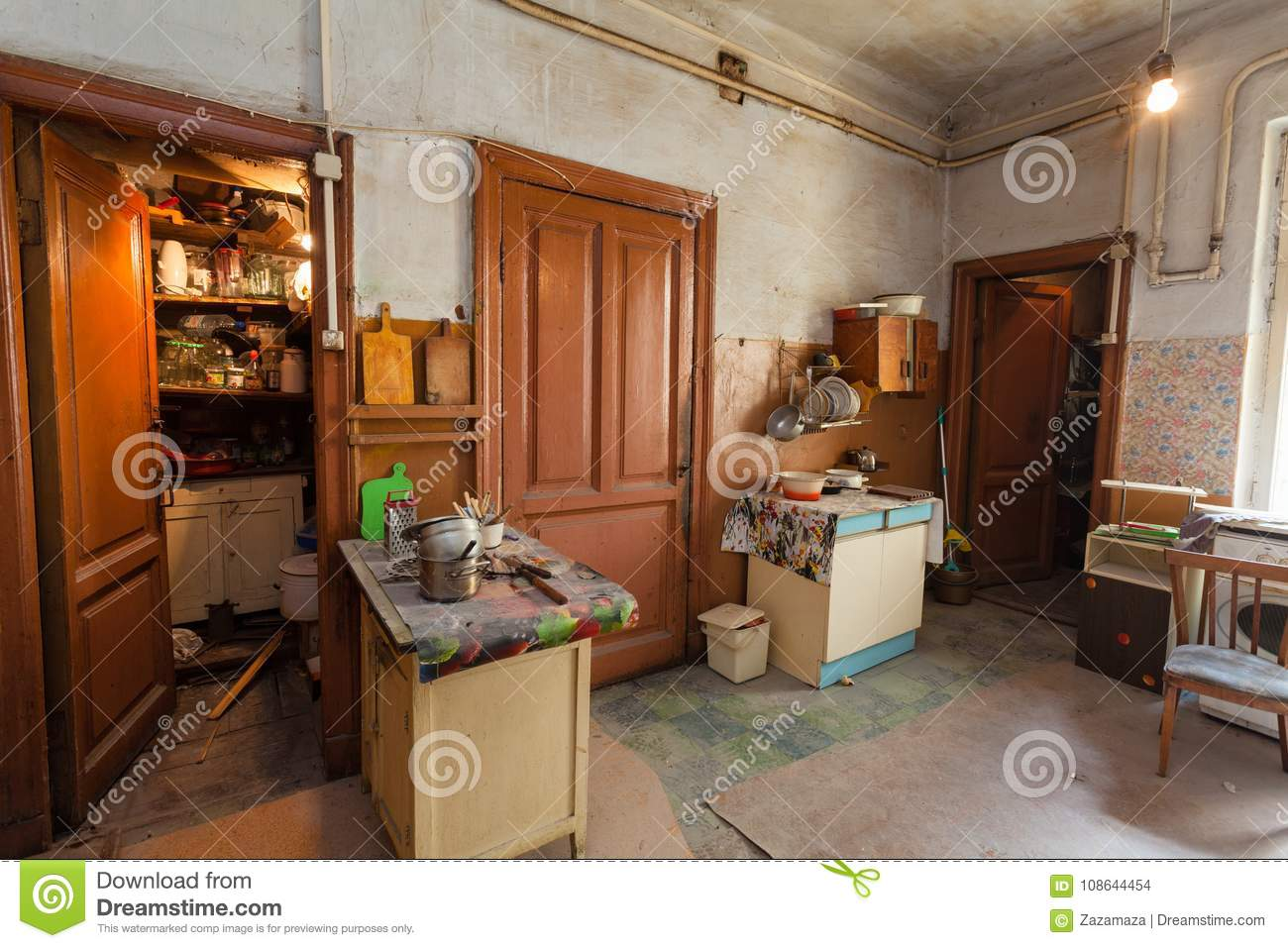 Dirty Kitchen With Furniture And Gas Stoves Is In The ...