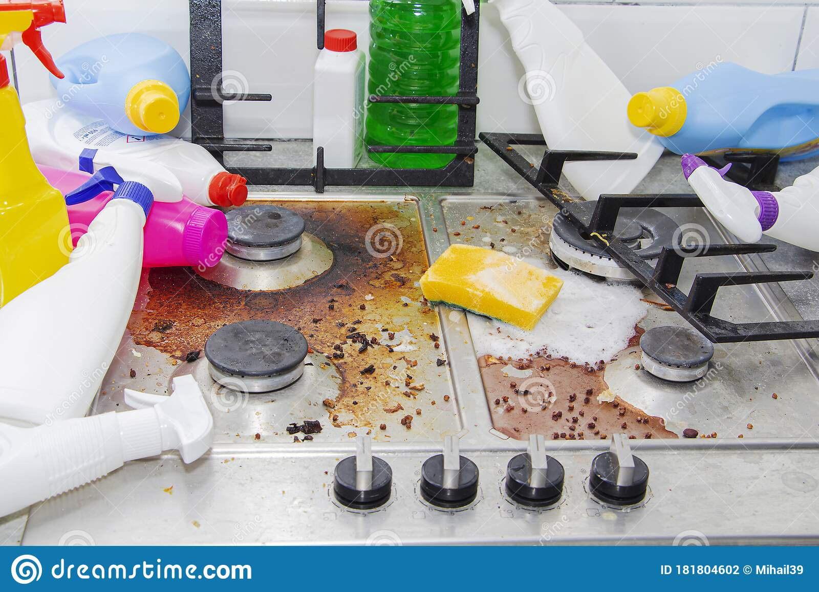 Dirty Kitchen Stove, Empty And Full Bottles Of Detergents
