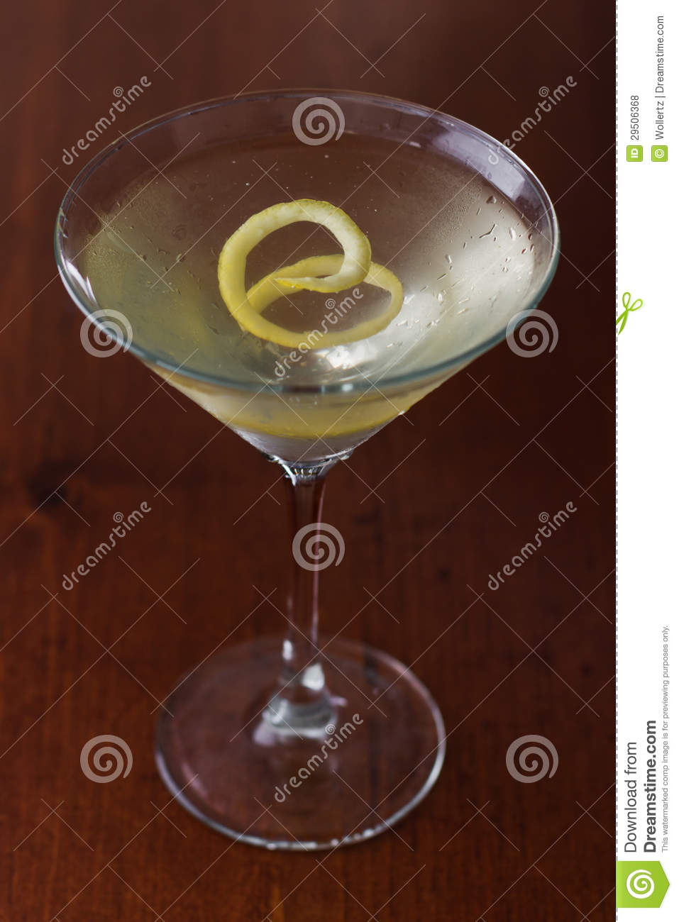 dirty martini with a lemon twist stock photo image of neat