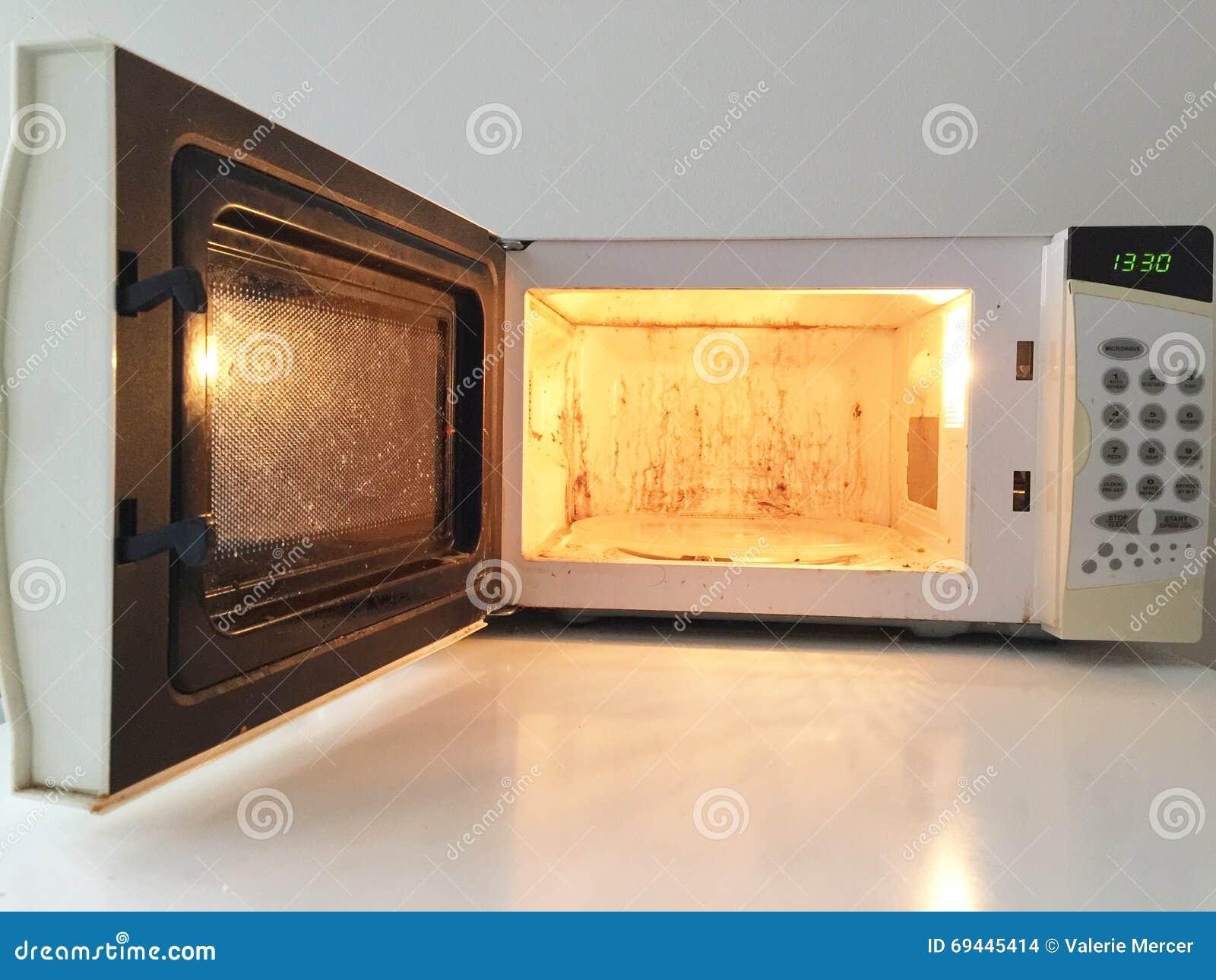 Dirty Microwave Oven ~ Dirty microwave oven stock photo image