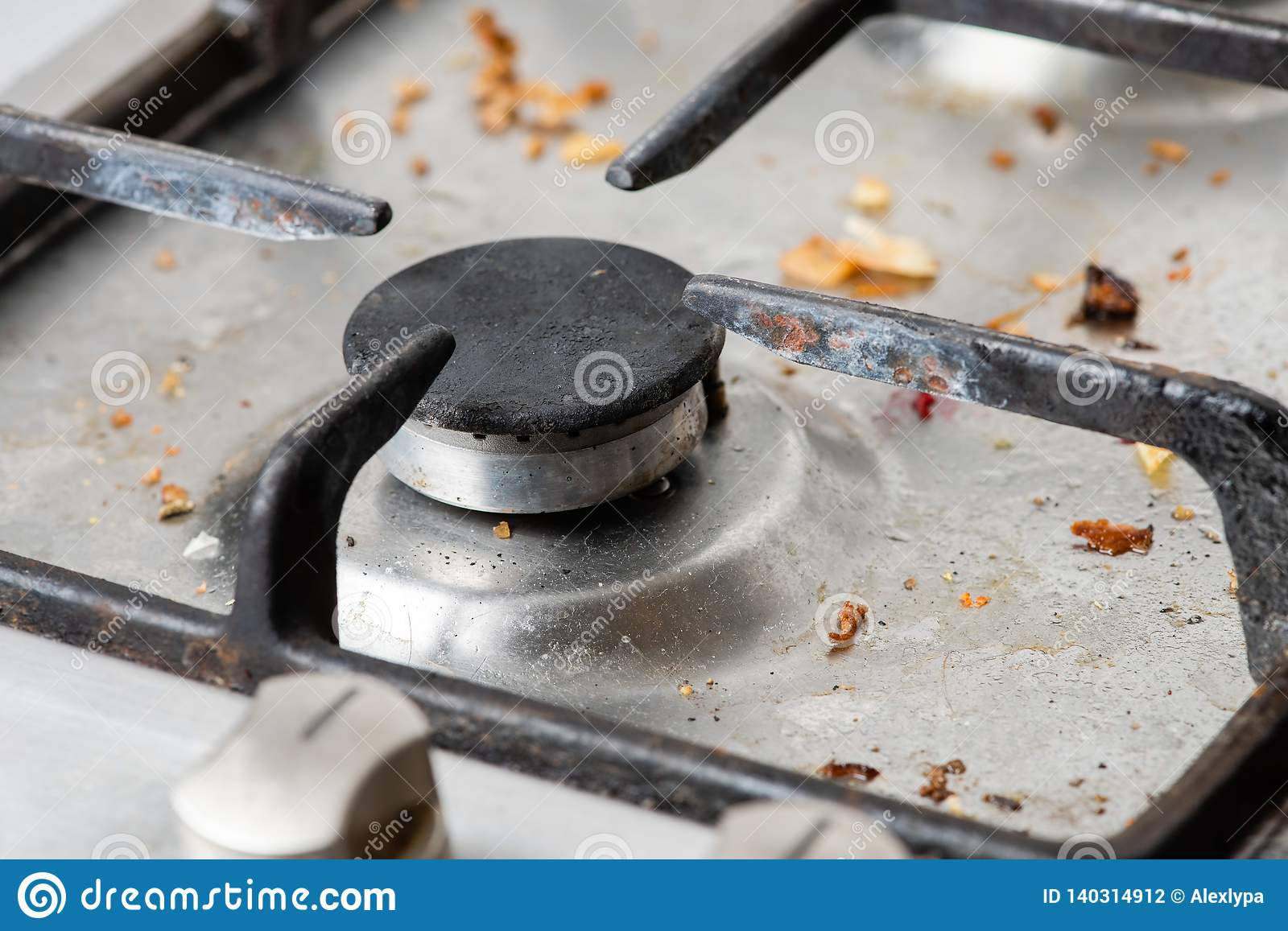 Dirty Modern Gas Stove With A Cast-iron Grill Stock Photo
