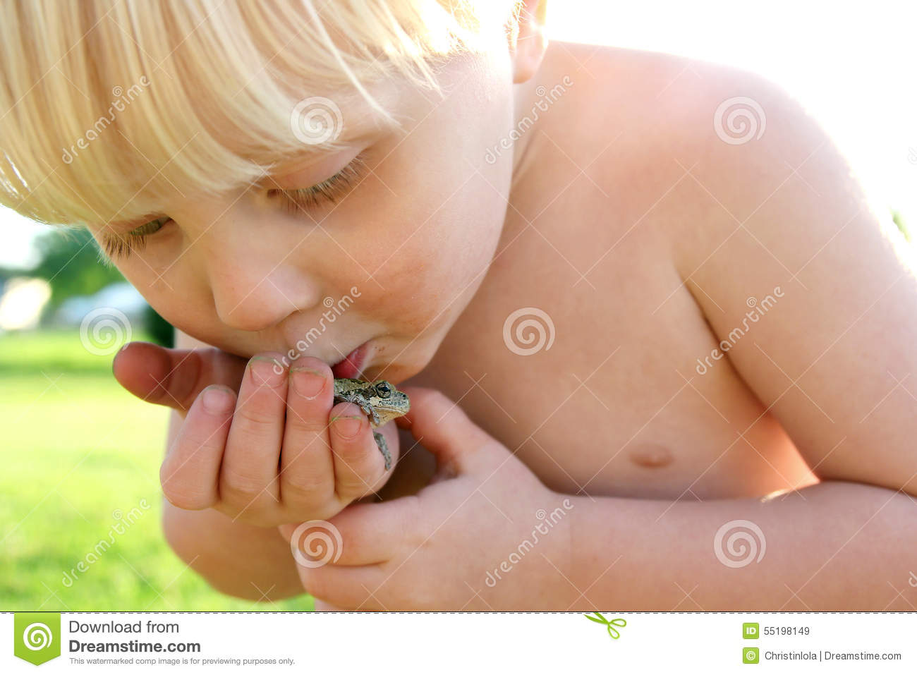 Dirty Toddler Playing Outside Kissing Frog
