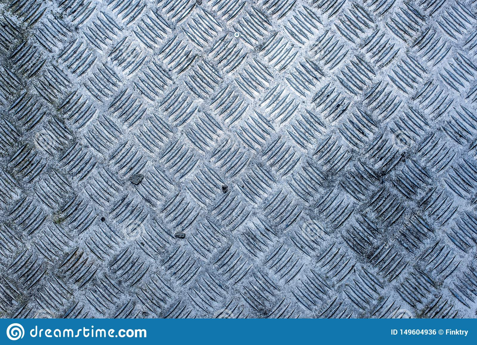 A dirty, worn and weathered diamond plate