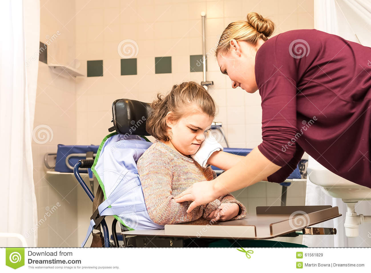 Disability A Disabled Child In A Wheelchair Being Cared