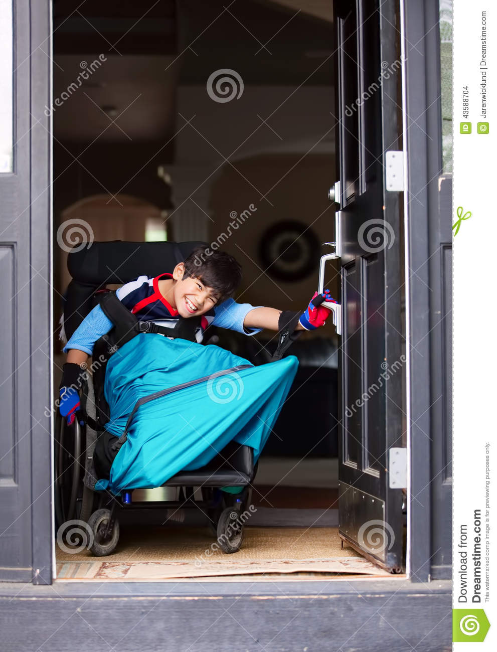 Disabled boy in wheelchair opening front door & Disabled Boy In Wheelchair Opening Front Door Stock Photo - Image ...