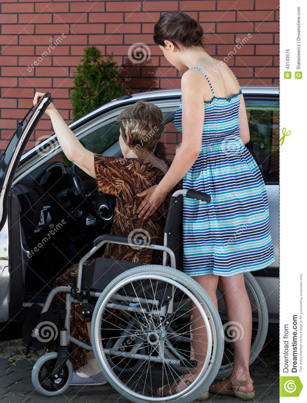 a disabled elderly woman getting into a car stock photo image 43143576. Black Bedroom Furniture Sets. Home Design Ideas