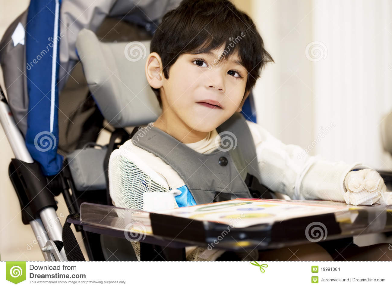 Disabled four year old boy studying