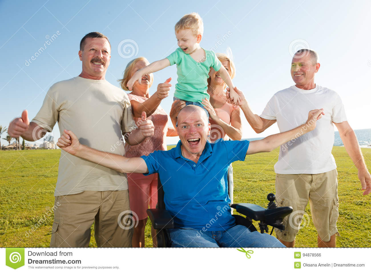 Disabled man with family.