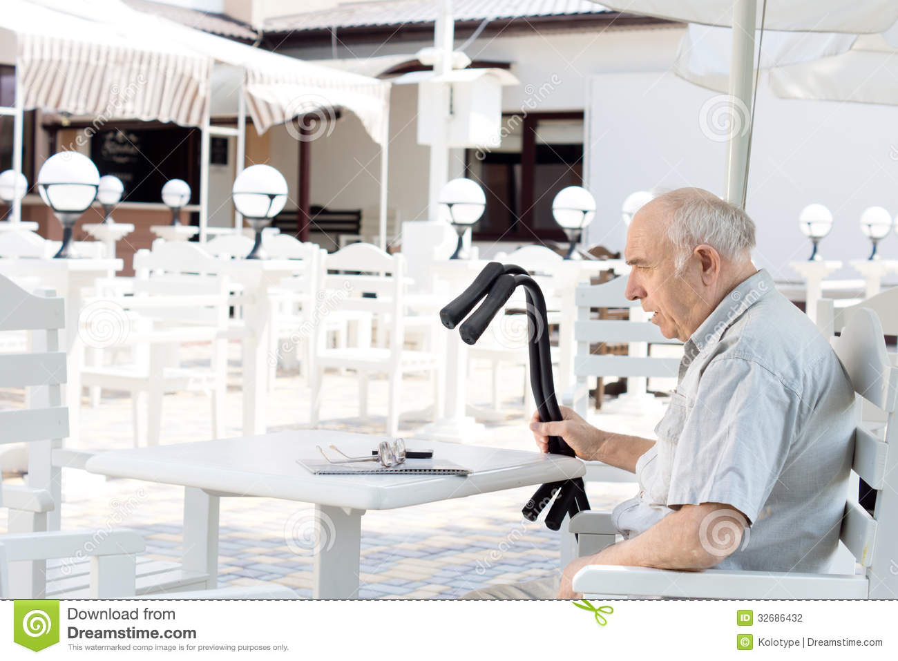 Disabled Man Sitting At An Outdoor Restaurant Stock