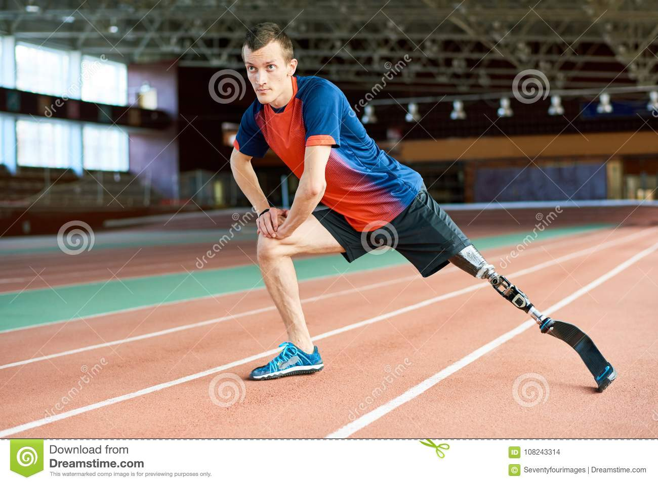 Disabled Runner Stretching in Stadium