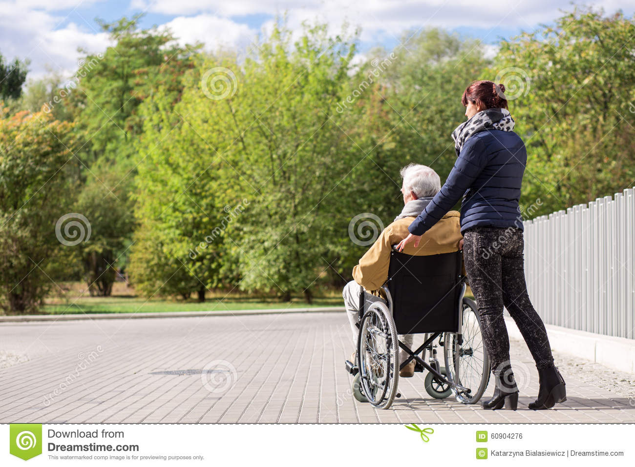 Smiling carer pushing an old man in a wheelchair stock photo image - Disabled Senior Graduate And Husband Royalty Free Stock
