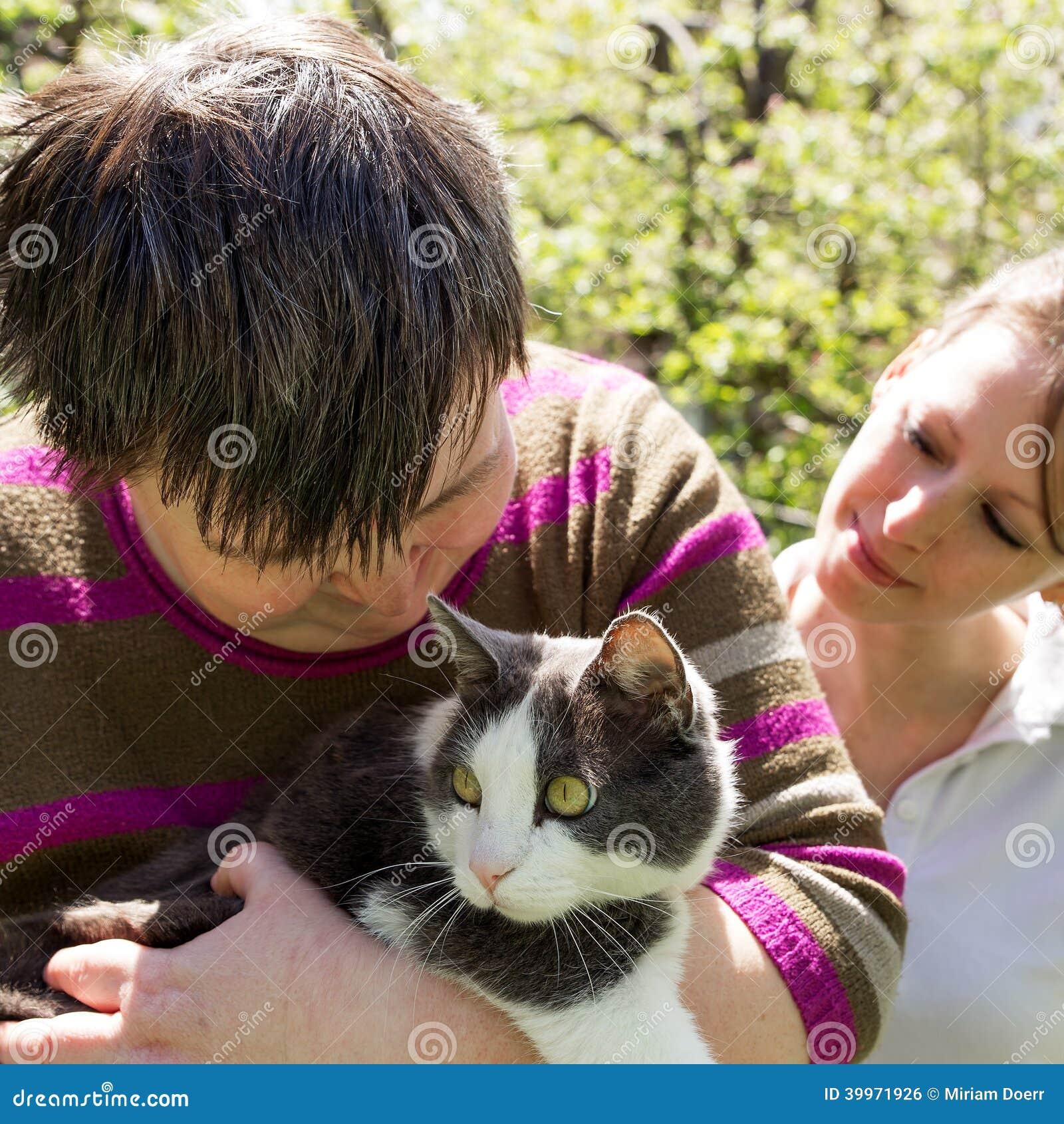 Disabled woman cuddles a cat