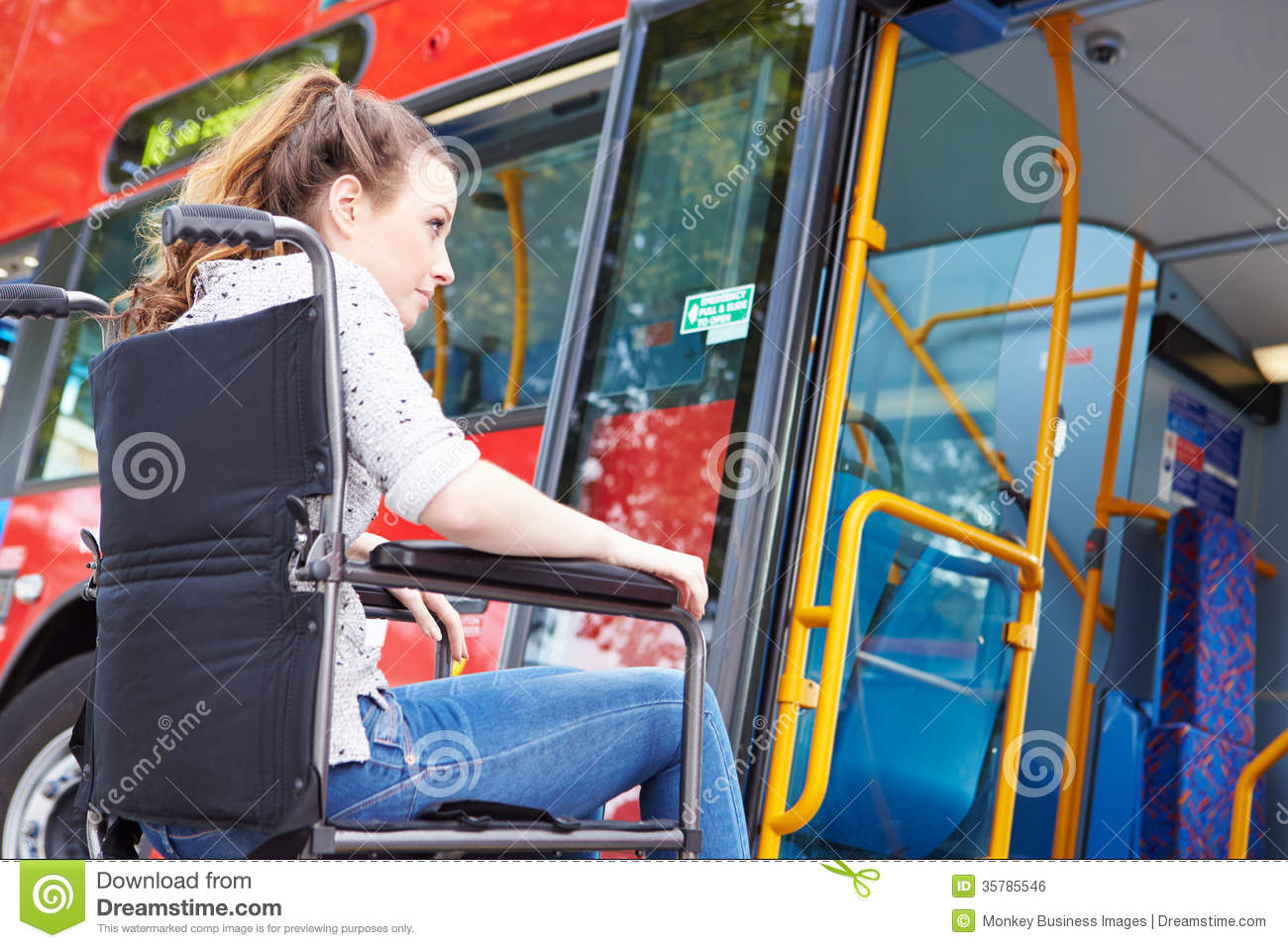 Disabled woman in wheelchair boarding bus stock photo for Handicapped wheelchair