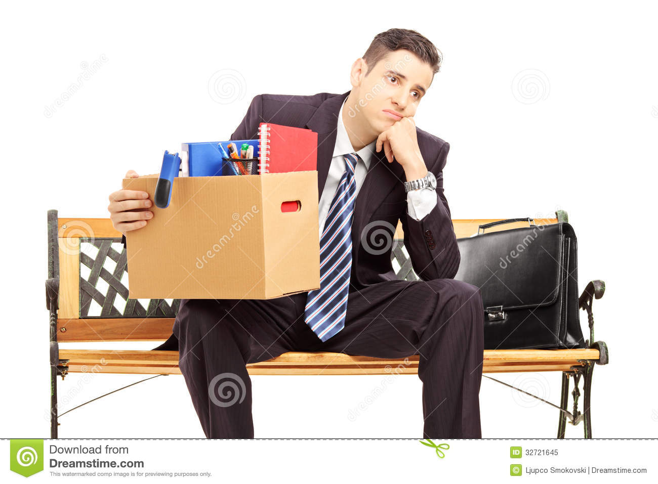 Disappointed Redundant Young Man In A Suit Sitting On A