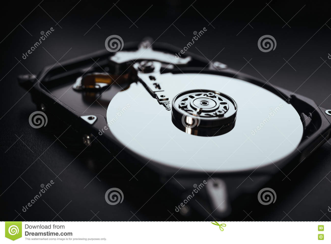 Disassembled hard drive from the computer (hdd) with mirror effects. Part of computer (pc, laptop)