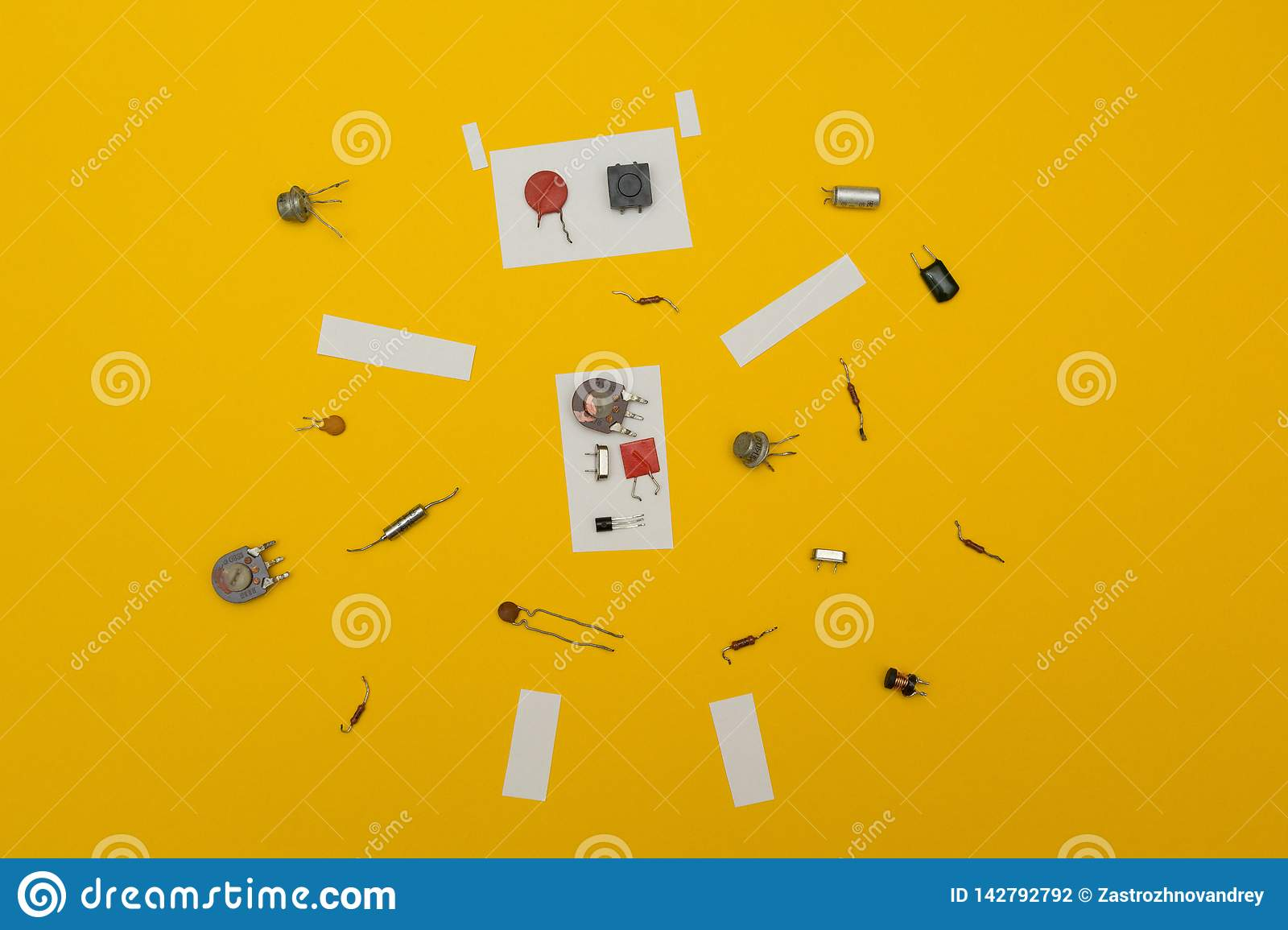 Disassembled robot on a yellow background