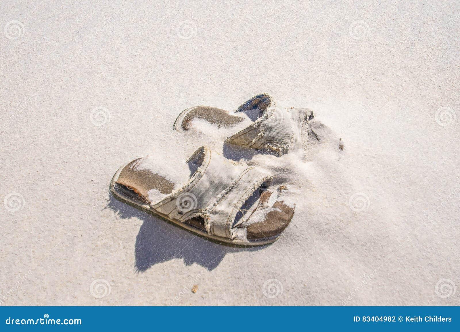 997935d65e08 A pair of men`s beach sandals left on the Florida coast.